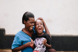 special needs orphan laughing
